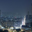 Hong Kong downtown at night with highrise buildings — Stock Photo #8117748