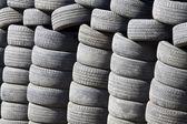 Many tyres and wheels under sunshine — Stock Photo