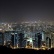 Hong Kong downtown at night with highrise buildings — Stock Photo #8348224