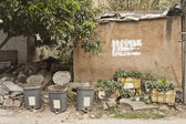Chinese village with houses and rubbish bins — Stock Photo