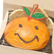 Stock Photo: Smiley face bread, greet for Chinese New Year.