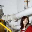 Asian girl in a factory — Stock Photo #8454797