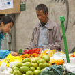 Stock Photo: Chinese hawker selling fruits