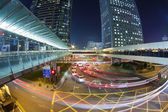 Traffic in downtown of a modern city at night — Stock Photo