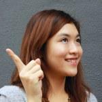 Asian woman with an idea — Stock Photo