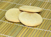 Rice biscuits on bamboo plate — Stock Photo
