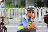 Guangzhou policeman on street, China — Stock Photo