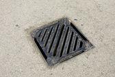 Drainage system the manhole on floor — Stock Photo
