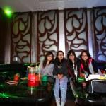 Asian friends in clubbing — Stock Photo