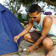Stock Photo: Asian man set up tent in camping