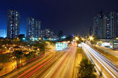 Modern city and traffic at night — Stock Photo