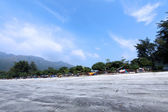 Beach in Hong Kong at day with campsites — Stock Photo