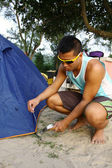 Asian man set up tent in camping — Stock Photo