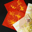 Red packets on black background — Stock Photo #9032135