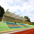 Stadium chairs and running track — ストック写真