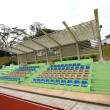 Stadium chairs and running track — Stock Photo #9032553