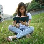 Asian girl reading in university — Stock Photo #9032854