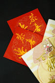 Red packets on black background — Stock Photo