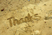 Thanks words on sand — Stock Photo