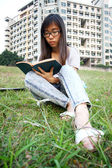 Asian girl reading in university — Stock Photo