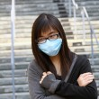Stock Photo: Asisick womwith mask
