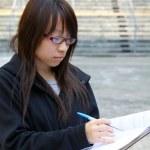 Asian girl studying in university — Stock Photo