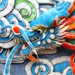 Stock Photo: Colorful dragon carvings on wall