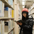 Asian woman studying in library — Stock Photo #9073935
