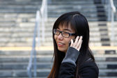 Asian woman talking phone — Stock Photo