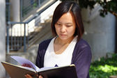 Asian girl studying in university — Stock Photo