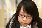 Asian woman thinking and studying in library — Foto Stock