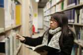 Asian university student in library — Stock Photo
