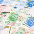 Hong Kong currency with different dollars background — Stock Photo #9113118