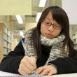 Asian woman studying hard in a university — Stock Photo #9128260