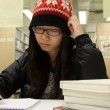 Asian woman studying in library — Stock Photo #9128330