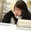 Asian woman studying in library — Stock Photo #9128404
