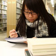 Asian woman studying hard in a university — Stock Photo #9128422