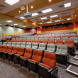 Lecture hall with colorful chairs in university — Stock Photo #9129322