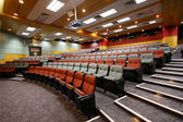 Lecture hall with colorful chairs in university — Fotografia Stock