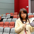 Asian student in lecture hall — Stock Photo