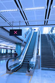 Moving escalator in train station — Stock Photo