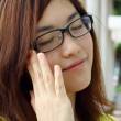 Asian woman with glasses — Stock Photo