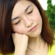 Asian woman with sleepy face — Stock Photo