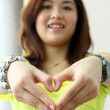 Asian woman making a heart — Stock Photo