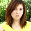 Asian woman with angry face — Stockfoto