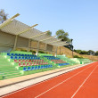 Stadium seats and running track — Stock Photo