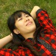 Asian woman sleeping on the grass and very relax — Stock Photo