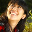 Asian woman smiling under sunshine — Stock Photo