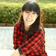 Asian woman happy in a park — Stock Photo #9146319
