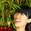 Asian woman happy in nature — Stock Photo